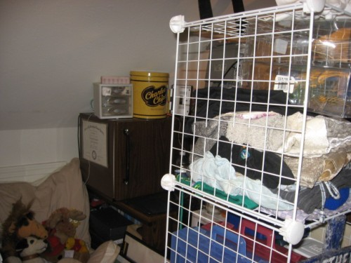 left side of wire cubes in forefront.  In the background is dorm frig. with vintage (yellow) snack can from Charles Chips)
