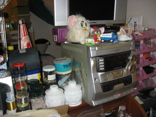on top of roll top desk misc storage jars, stereo and flat panel LCD TV #12